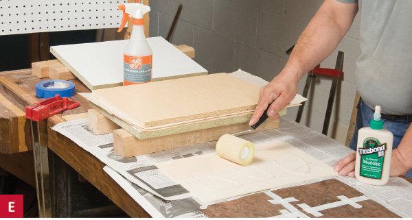 Applying glue as part of wood veneer setup and installation.