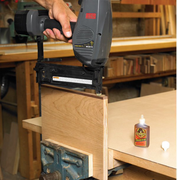 Glue and tack technique for installing wood veneer banding.